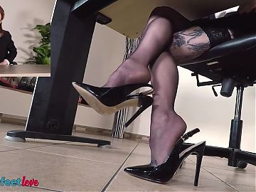 Redhead secretary shows off feet while talking on the phone